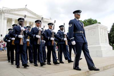Members of the Air Force Honor Guard descend the steps at the Tomb of the Unknown Soldier after the ceremony.