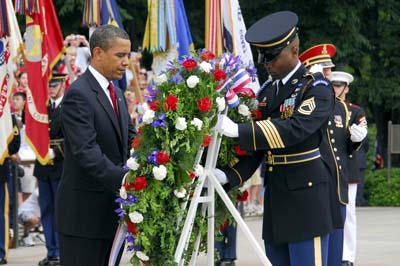 President Obama places a wreath at the Tomb of the Unknown Soldier at Arlington National Cemetery.